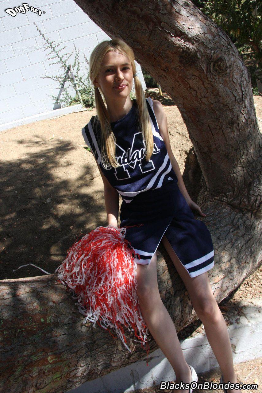 Skinny blonde cheerleader Kennedy Kressler gives it up to a massive black cock