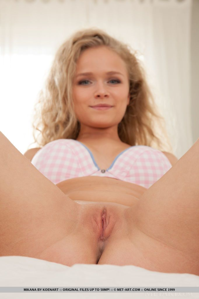 Blonde babe revealing shaved teen vagina during glamour photo shoot