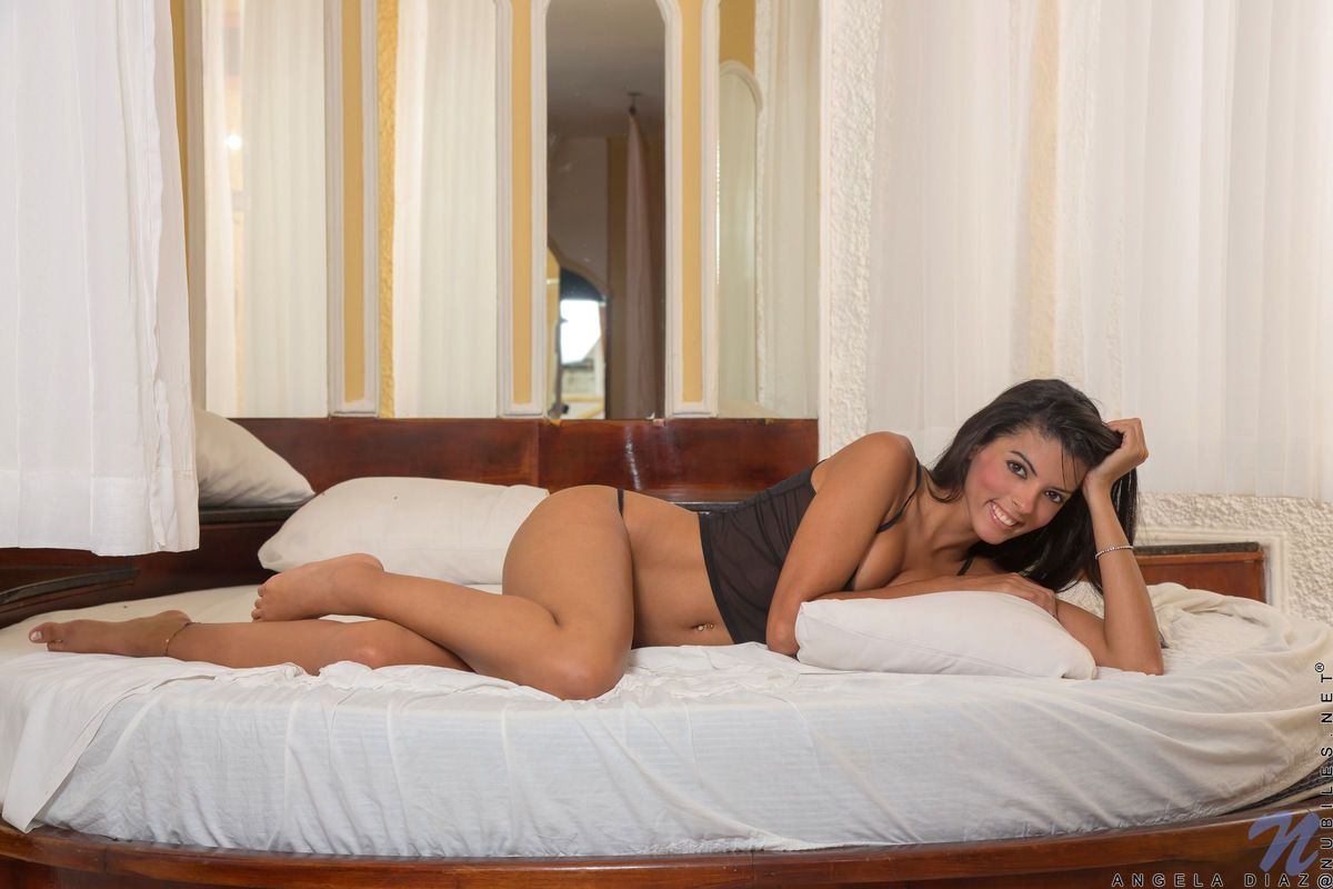 Smiling coed Angela Diaz whips out a vibrator for her morning masturbation