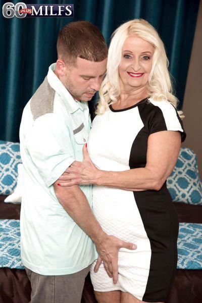 Blonde granny Vikki Vaughn loosing saggy boobs to seduce younger man for sex