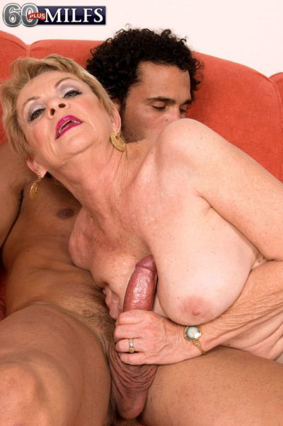 Horny grandma Lin Boyde seducing younger Latino man for sex on chesterfield - part 2