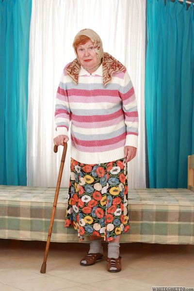 Fat old granny Alice with cane posing fully clothed in long skirt and socks