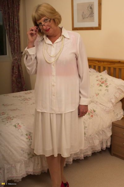 Horny old granny shyly removes her Sunday best to show her garter belt and ass