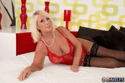 Sexy blonde granny seduces her young lover in hot lingerie and stockings