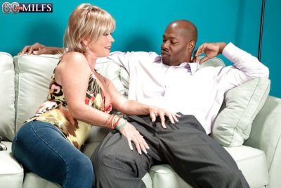 Blonde grandma Lexi McCain giving large black cock oral sex on knees