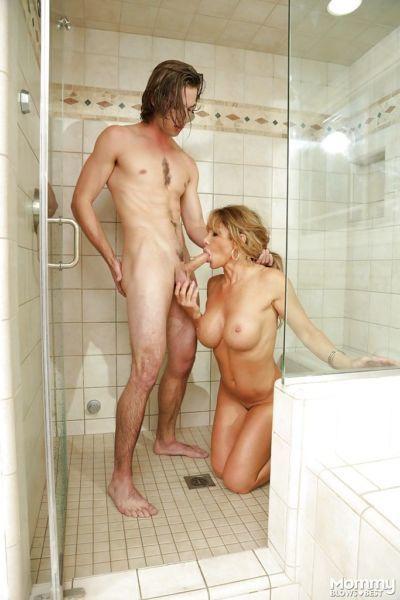 Busty MILF Farrah Dahl kneels to suck heavy cock in the shower