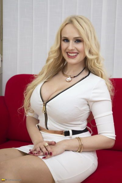 Older blonde in thigh cut dress whips out her big tits and pierced nipples