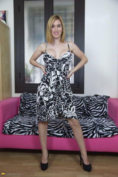 Older mom slides lace panties aside before banging on Zebra print covered sofa