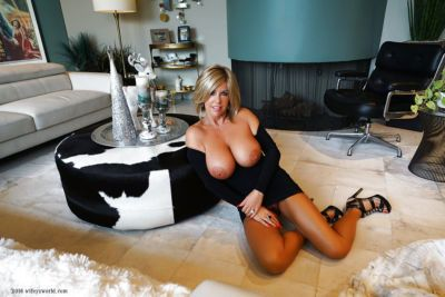 Mature housewife Sandra Otterson showing off knockers and great legs - part 2