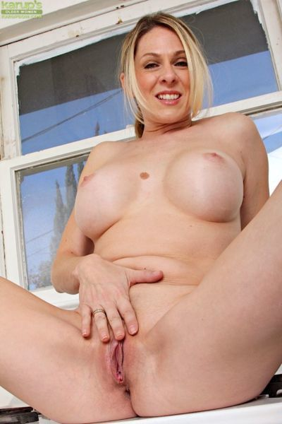 Amazing busty blonde mature Angela Attison spreading her hairy cunt - part 2