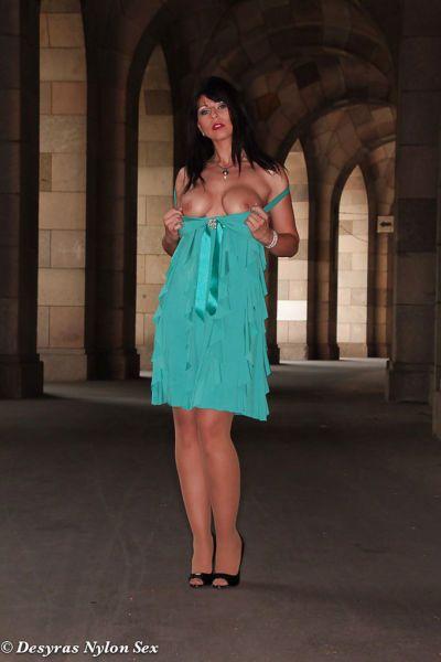 Mature European babe Desyra Noir posing topless in nylons in public - part 2