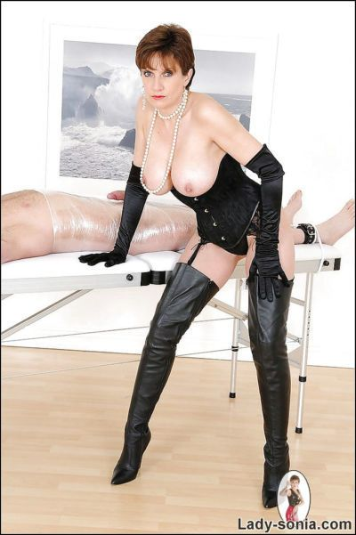 Hot femdom in black boots and lingerie jerking her boyslaves dick - part 2