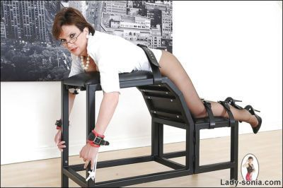 Well-graced BDSM lady in black nylon pantyhose posing tied