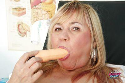 Fatty mature lady with massive flabby jugs toying her bushy twat