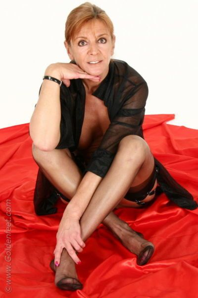 Aged Euro woman Lady Sarah fondling mature boobs while modeling pantyhose