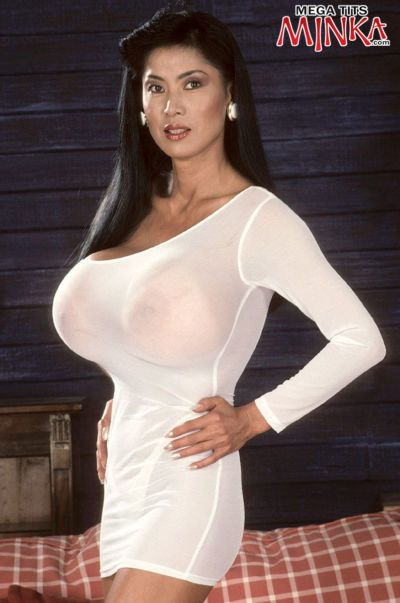 Hot mature Minka has an enormous set of tits which she hangs out of her top