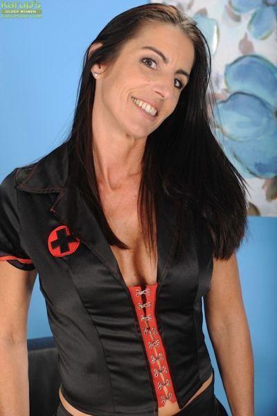Mesh stocking attired mature lady Katrina Kink exposing big boobs