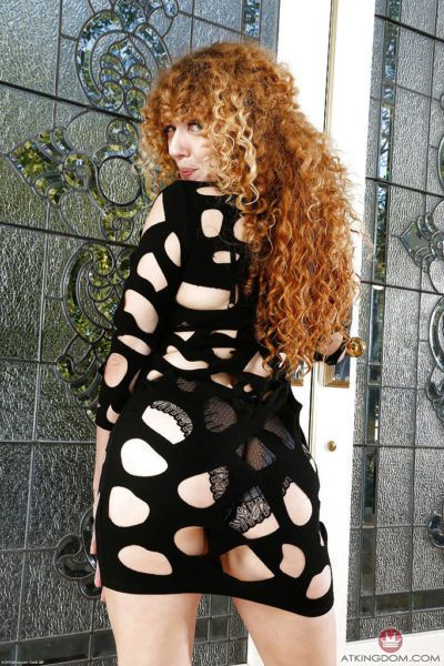 Older solo model Leona slipping undies aside to display hairy ginger pussy