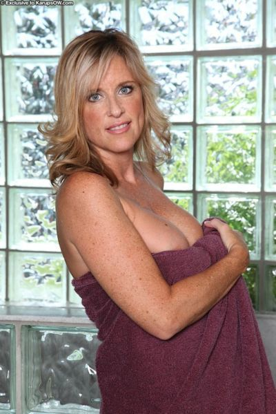 Mature woman Jodi West demonstrating big tits while masturbating in shower