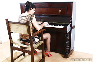 Aged mature woman Lady Sarah playing piano in see thru mesh outfit
