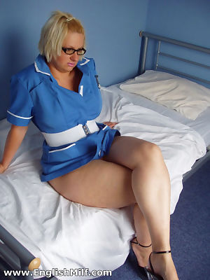 Mature plumper Daniella English hikes her uniform and spreads pussy lips
