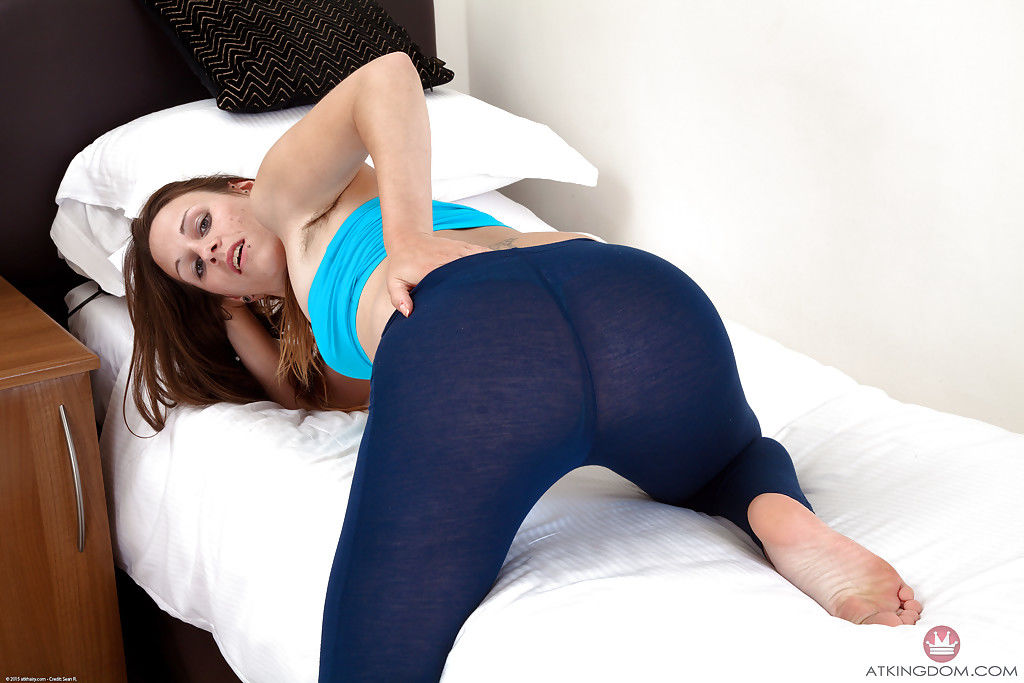 Older model Kitty displaying hairy legs and beaver after doffing yoga pants