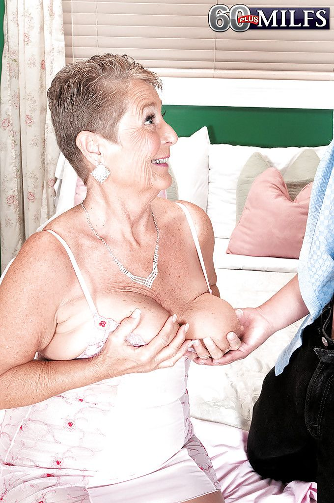 Big boobed grandma Joanne Price giving oral sex before riding dick