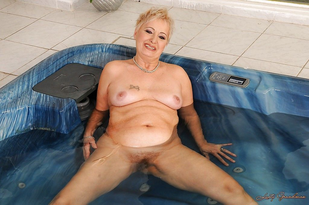 Short haired fatty granny stripping off her lingerie and posing in the pool - part 2