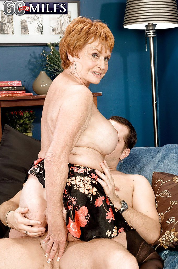 Redhead granny Valerie instructing a younger man on finer points of hard sex - part 2