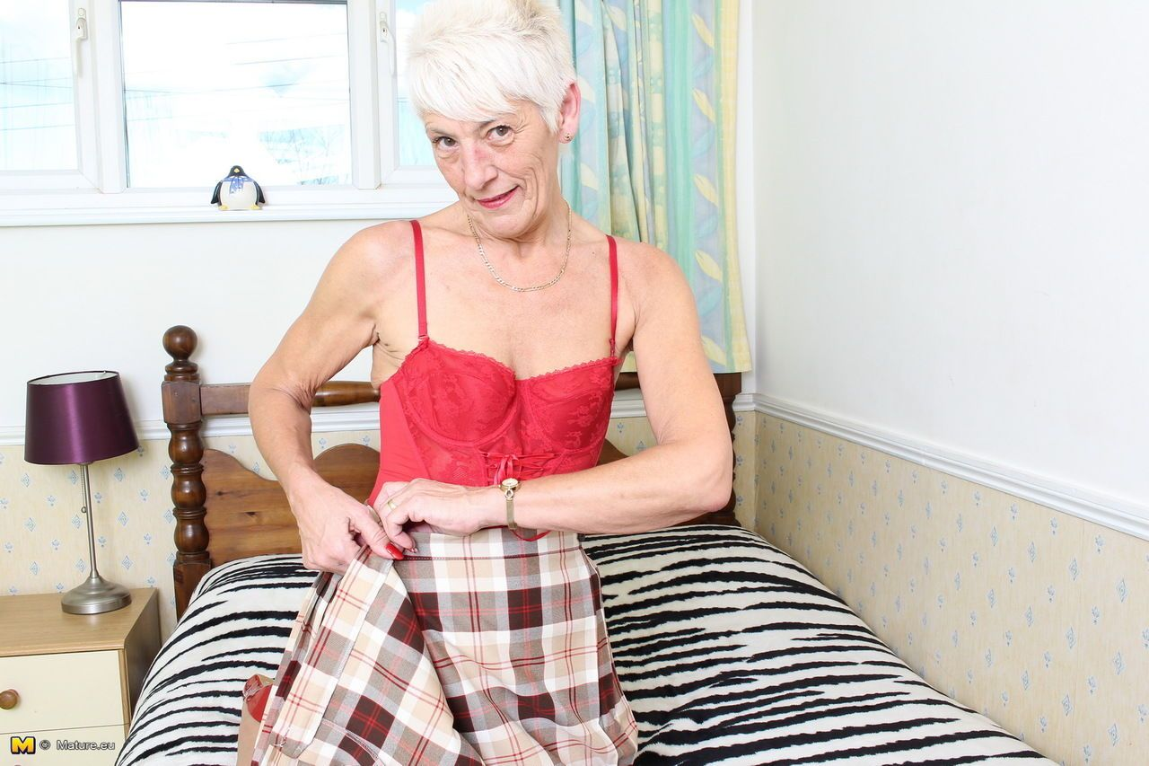 Over 70 Bristish granny takes off her clothes and lingerie striptease style