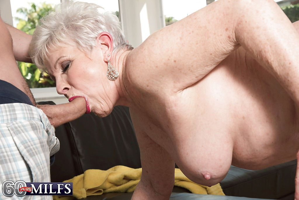 Short haired granny gives big cock a blowjob and takes cumshot on face
