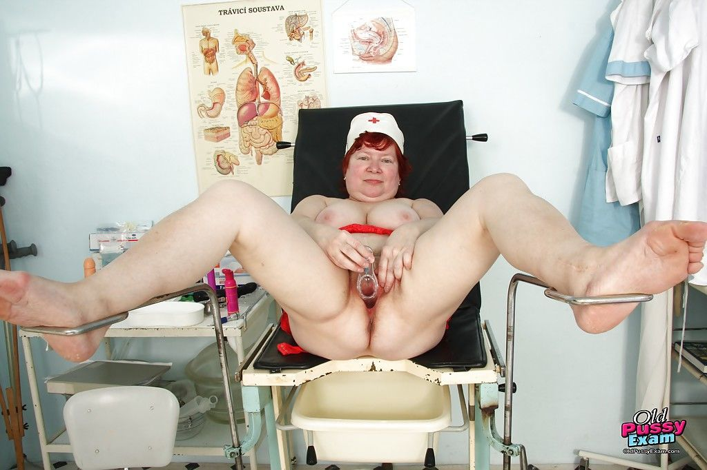 Chubby redhead granny masturbating her unshaven cunt in gyno office