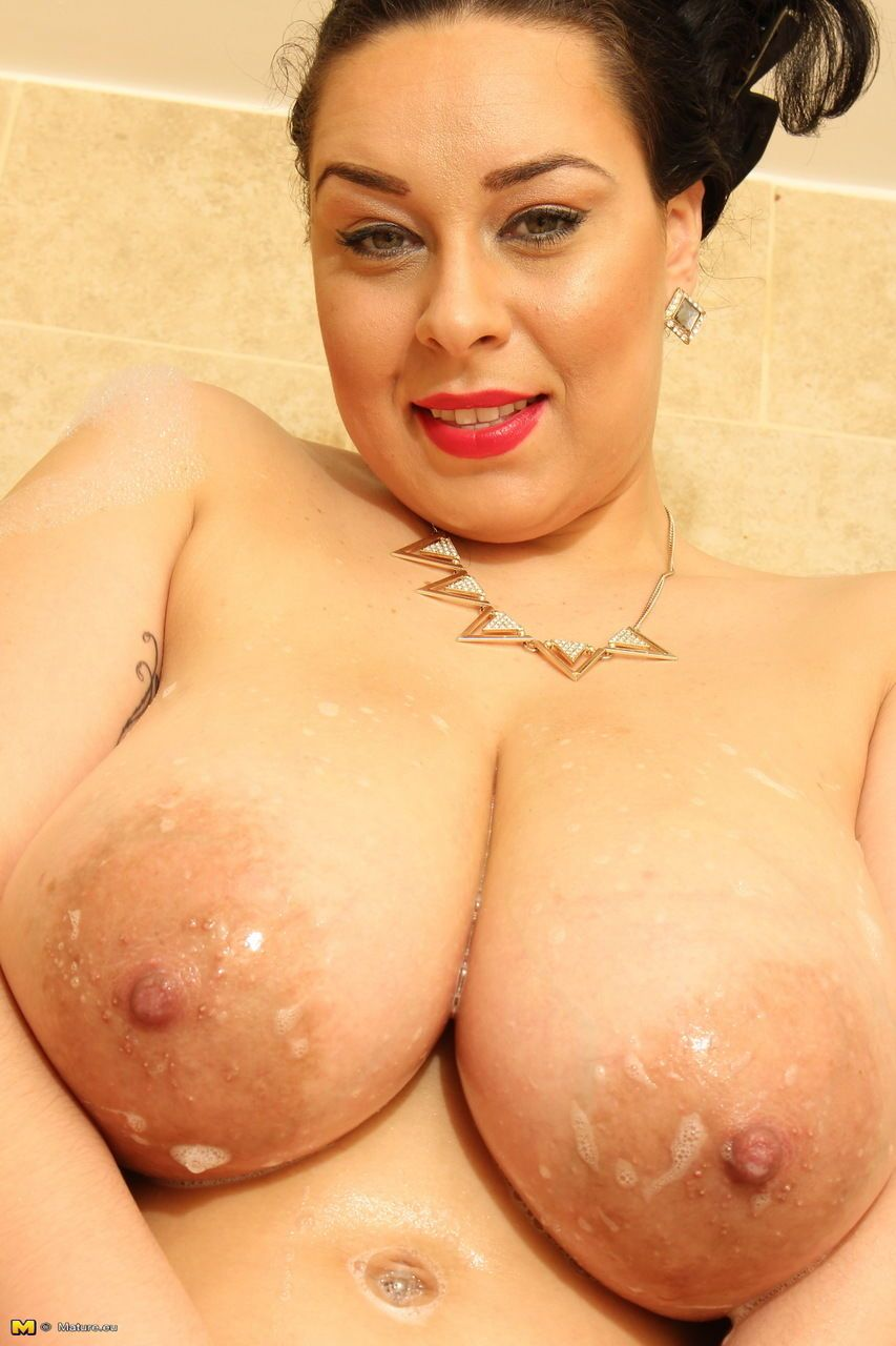 Obese brunette mom wets her huge breasts in shower after stripping naked