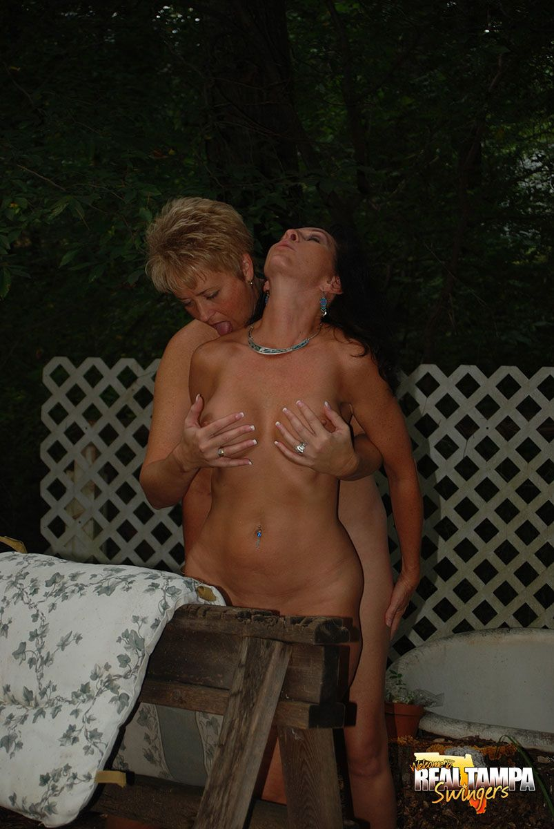 Hot mature MILF Tracy Lick fucking doggystyle with strapon in the back yard