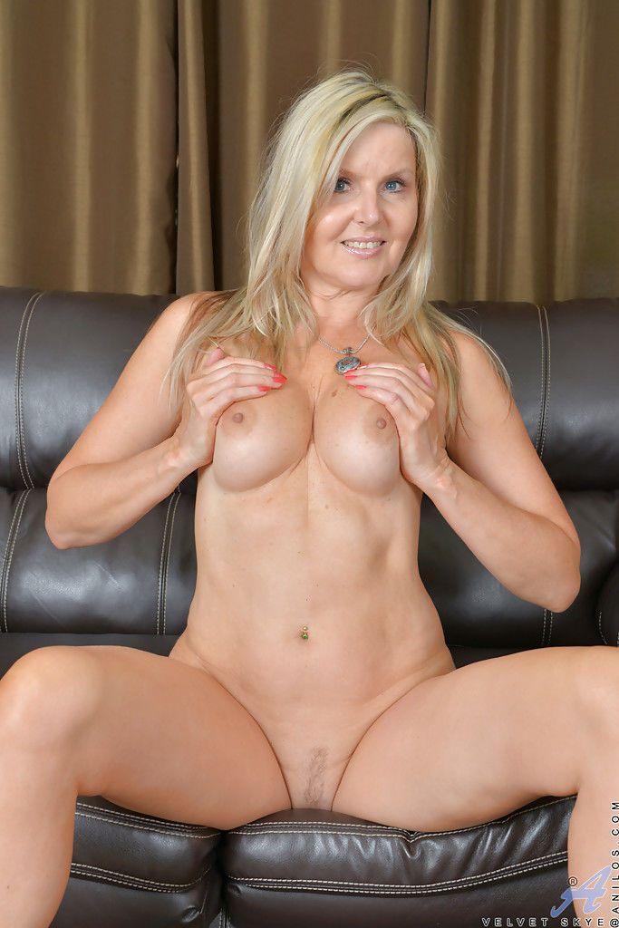 Older blonde babe Velvet Skye baring small tits and hairy vagina
