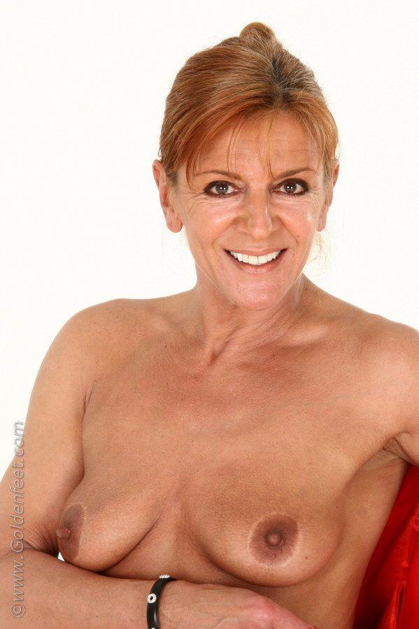 Aged Euro woman Lady Sarah fondling mature boobs while modeling pantyhose