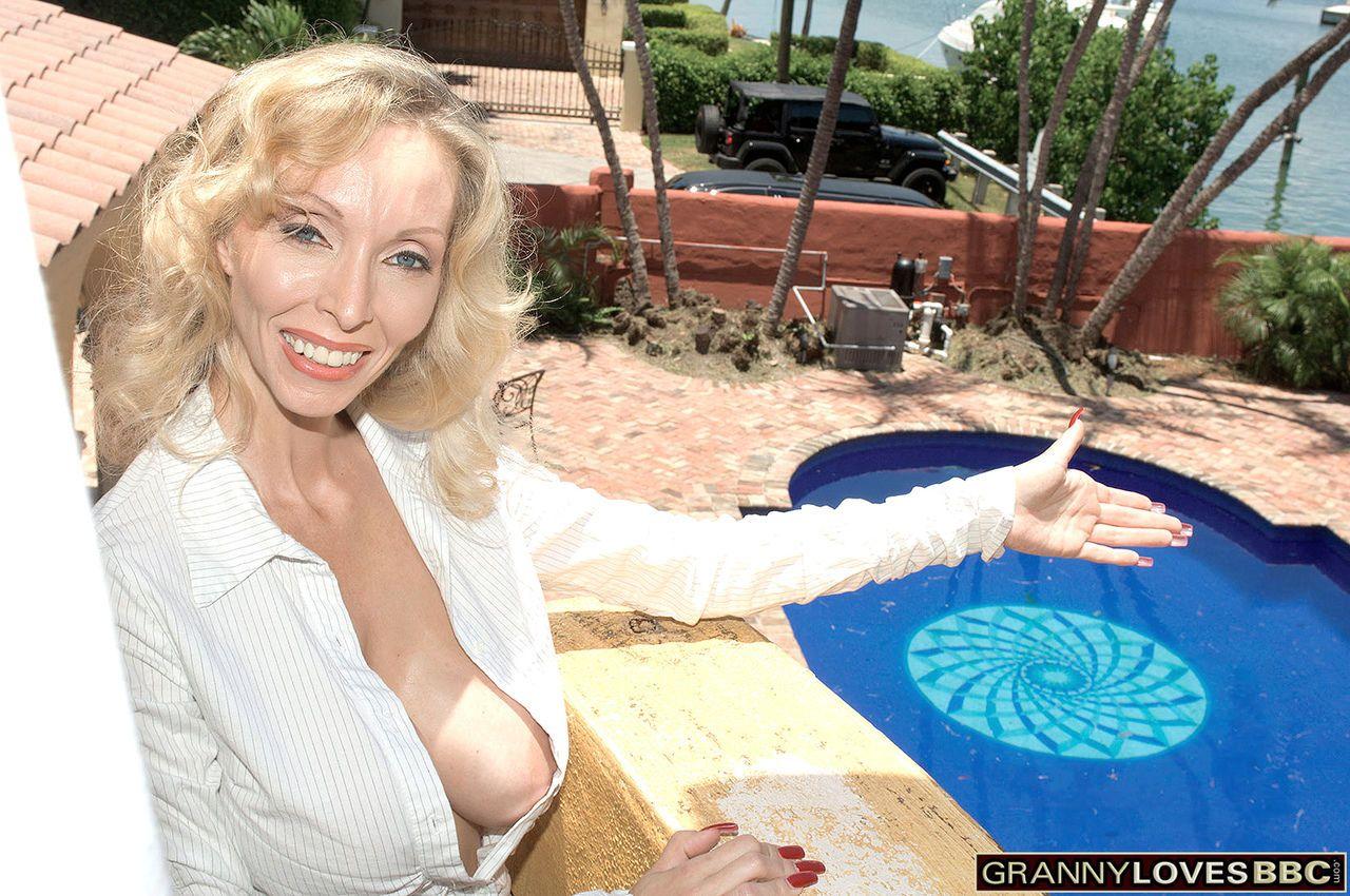 Hot blonde granny Ophelia Vixxxen invites a BBC inside to fuck her doggystyle