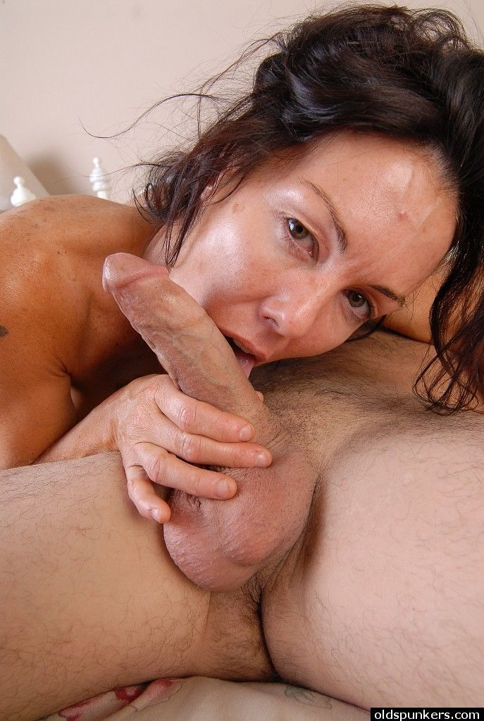 Mature brunette Nancy taking cumshot on face after ball licking and blowjob