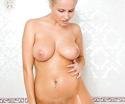 Christa- blonde- nude- bath tub-..