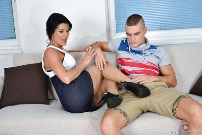 Hot brunette chick Celine Noiret gives a foot job and grinds on a massive cock