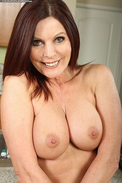 Smiley mature vixen stripping down and spreading her nylon clad legs