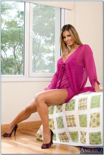 Horny blonde latina with big tits Esperanza Gomez poses in high heels.