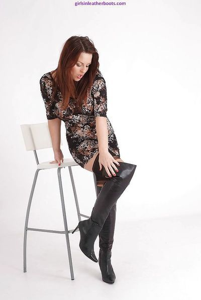 Solo babe Candi removing over the knee leather boots and nylons