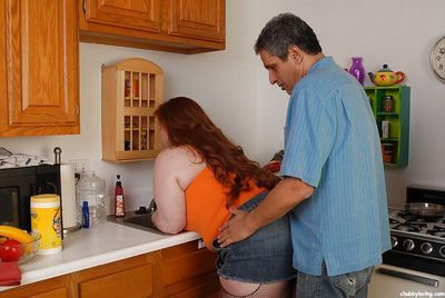 Very fatty Julie is being drilled in her booty right in the kitchen