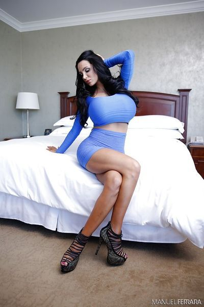 Unbelievably bust brunette Amy Anderssen playing with her huge tits