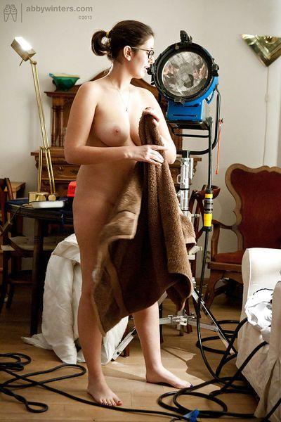Brunette amateur Ariel D getting dressed after posing naked