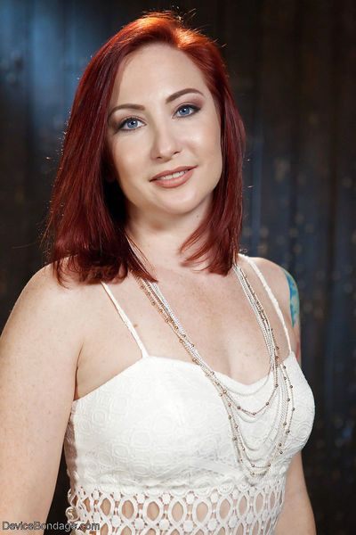 Chubby redhead chick Sophia Locke paddled and flogged in bondage