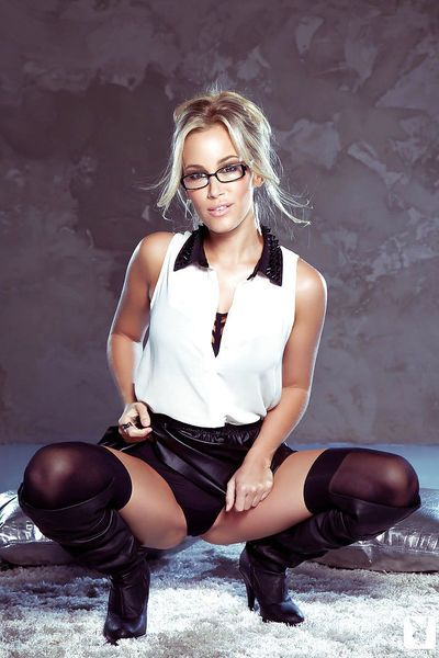 Stunning blonde in glasses and high-heeled boots uncovering her gorgeous body