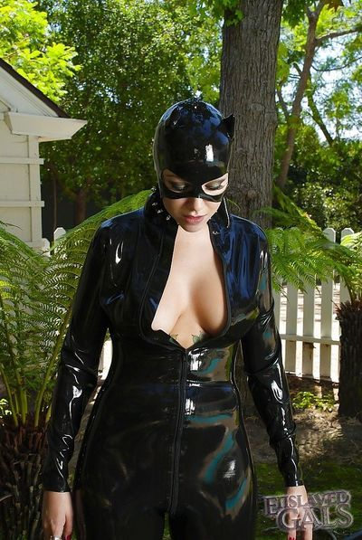 Purty babe in latex outfit Emily Parker pours milf on her tits