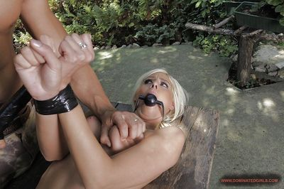 Submissive blonde girl gets involved into rough and painful fucking outdoor